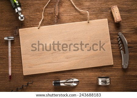 Set of wine accessories on a wooden background   - stock photo