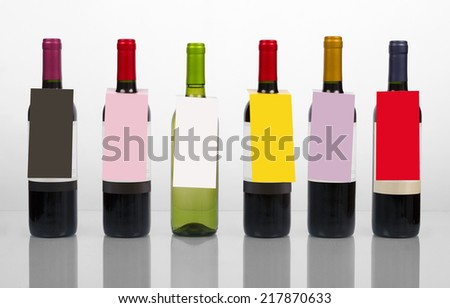 Set of wine bottles with tags - stock photo