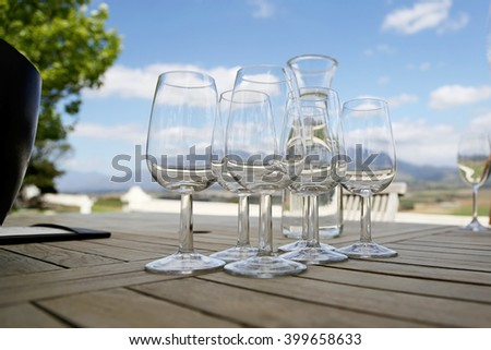 Set of wine glasses on the table with jug of water. Wine tasting. - stock photo