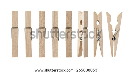 Set of wooden clothes pins , clipping path , white background - stock photo