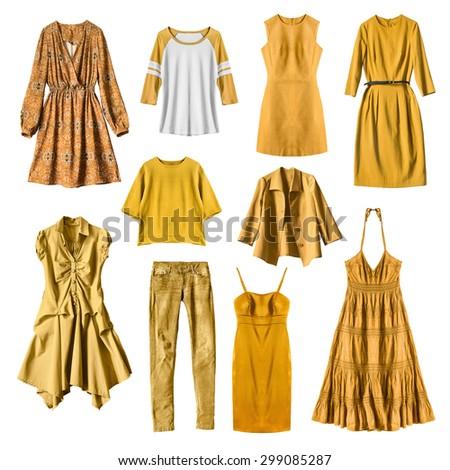 Set of yellow female clothes on white background - stock photo