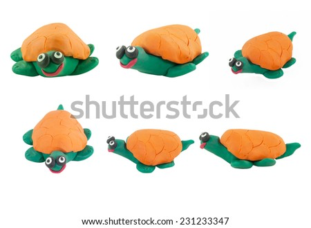 Set of yellow turtle made from plasticine on white background - stock photo