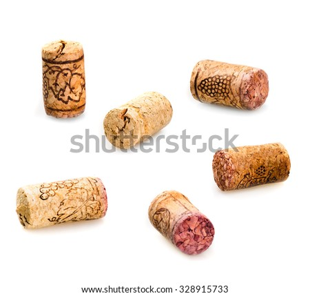 set old wine corks isolated on white - stock photo