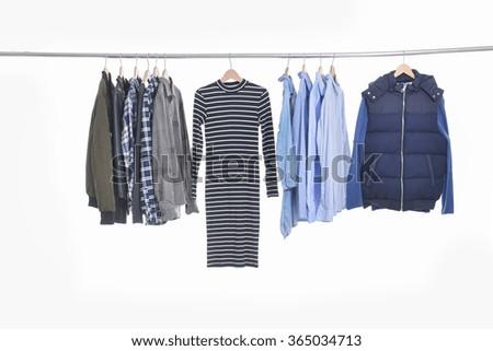 Set shirts ,clothing on hangers on a white background  - stock photo