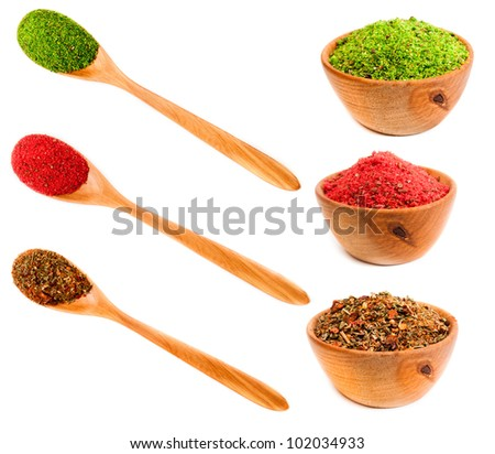set spices in a wooden platters and spoons isolated on a white background - stock photo