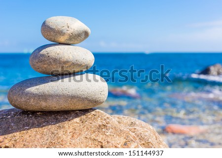 Set stones to relax with the sea in background - stock photo