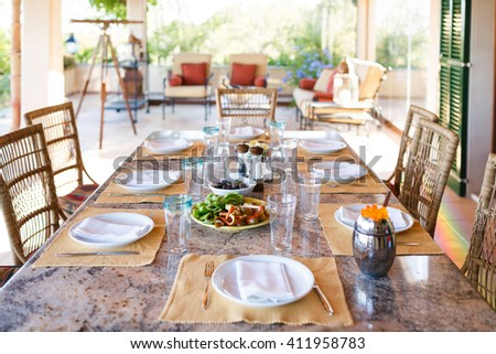 Set the table before the lunch in veranda of the Spanish home, Mallorca - stock photo