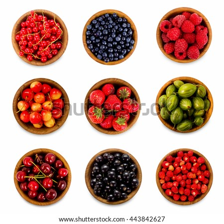 Set various berries. Strawberries, currant, cherry, raspberries, gooseberries and bilberry. Collage of different fruits and berries isolated on white. Ripe and tasty berry. - stock photo