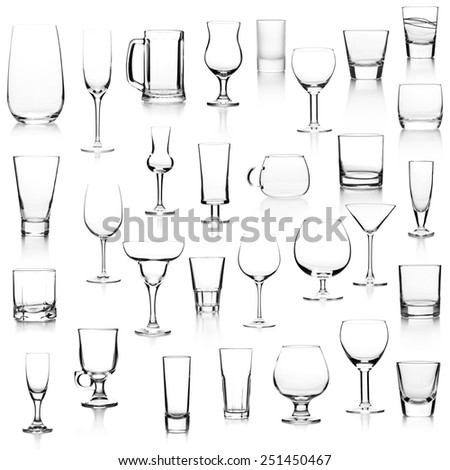 Set with different empty glasses on white background - stock photo