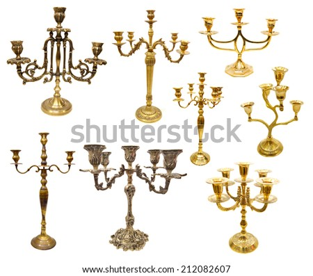 Set with various candle holders and candlesticks isolated on white - stock photo