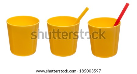 Set Yellow plastic cup with red and yellow straw isolated on white background - stock photo