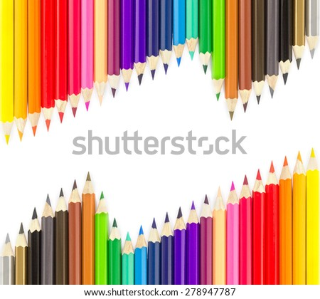 Sets of colored pencils in rows on white background - stock photo