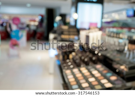 sets of makeup in department store shopping mall, image blur defocused background - stock photo