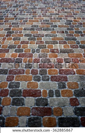 Sett. Old road made of stone. Tile color. Sett square. Stone paved road. Krasivyya winter road. Background. The texture of the stone. Rakushnik. Concrete. Cement. Granite. Limestone. Marble. - stock photo