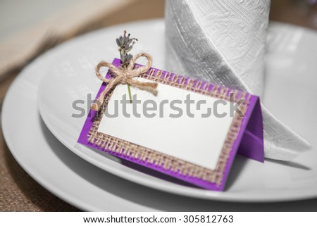 setting cards on the table in the style of Provence - stock photo