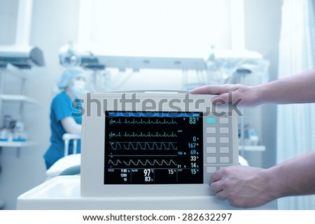 Setting equipment in the intensive care ward - stock photo