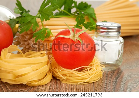 Setting pasta with tomato and garlic - stock photo