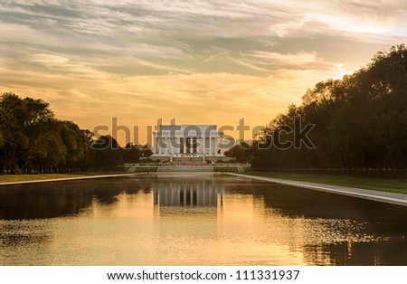 Setting sun illuminates Jefferson Memorial in Washington DC with reflections in new Reflecting Pool - stock photo