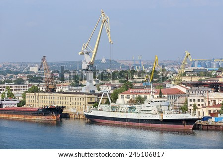 "SEVASTOPOL, REPUBLIC OF CRIMEA, RUSSIA - AUG 10, 2014: Shipbuilding company LLC ""Sevmorverf"" that is part of the JSC ""Sevastopol marine plant"" - stock photo"