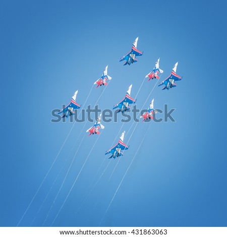 Sevastopol, Russia - June 5, 2016: Air show military aircraft. Russian Knights and Swifts. Aviadarts 2016 - stock photo