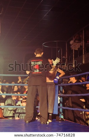 SEVASTOPOL, UKRAINE - 03 APRIL: Referee close to fighter at Ukrainian championship MIX FIGHT, April 03, 2011 in Sevastopol, Ukraine. - stock photo