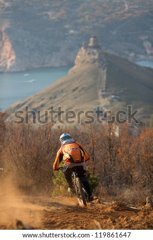 "SEVASTOPOL, UKRAINE - NOVEMBER 25: Unknown racer on the competition of the mountain bike ""Listopad Bike Session 2012"" on November 25, 2012 in Sevastopol, Ukraine - stock photo"