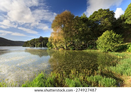 Seven Cities Lagoon in São Miguel, is one of the many lakes of volcanic origin, formed in craters of volcanoes. The Azores have amazing natural landscapes and are holiday destination of Portugal. - stock photo