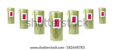 Seven green candles stand in v-like structure - stock photo