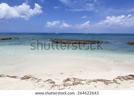 Seven Mile Beach waters on Grand Cayman island. - stock photo