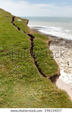 Seven Sisters National Park, view of the cliffs and the beach, East Sussex, England. Crack on the cliff edge. - stock photo