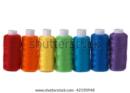 seven spools rainbow colors  isolated on white - stock photo