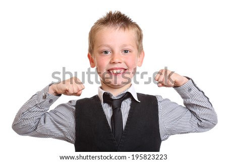 Seven year old boy acting like a strongman - stock photo