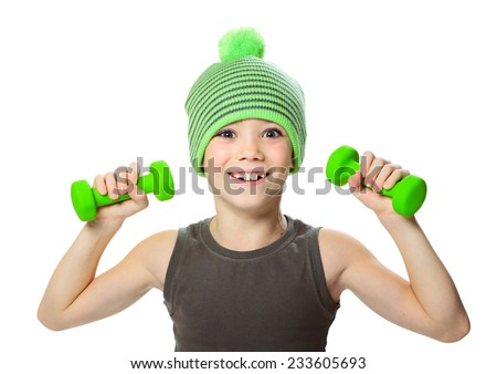 Seven years boy is doing exercises to develop muscles isolated on white background - stock photo