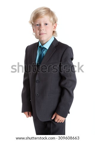 Seven years old blond schoolboy in school uniform, suit, shirt and tie, isolated on white background - stock photo