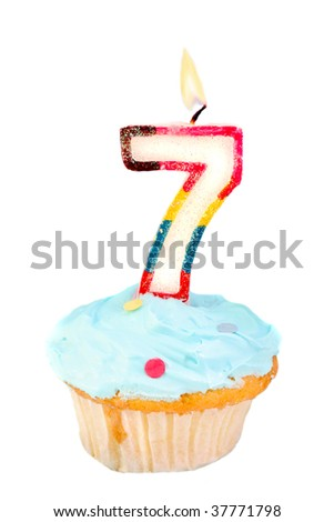 seventh birthday cupcake with blue frosting on a white background - stock photo