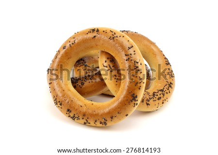 Several bagels with poppy seeds on a white background - stock photo