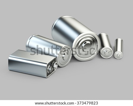 Several batteries closeup view on a grey background - stock photo