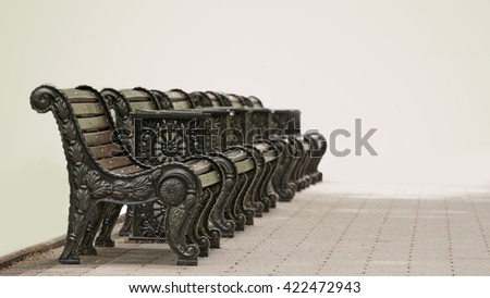 Several benches standing in a row in parke. - stock photo