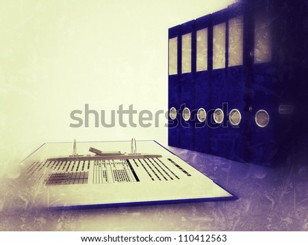 several binders in a business context - stock photo