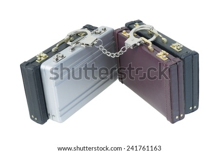 Several Briefcases connected with handcuffs - path included - stock photo