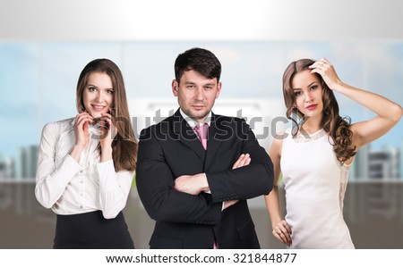 Several business people stand in office reception - stock photo
