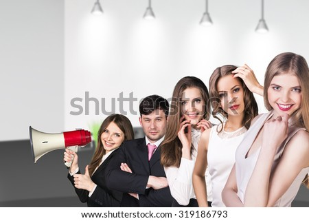 Several business people stand in the office hall - stock photo