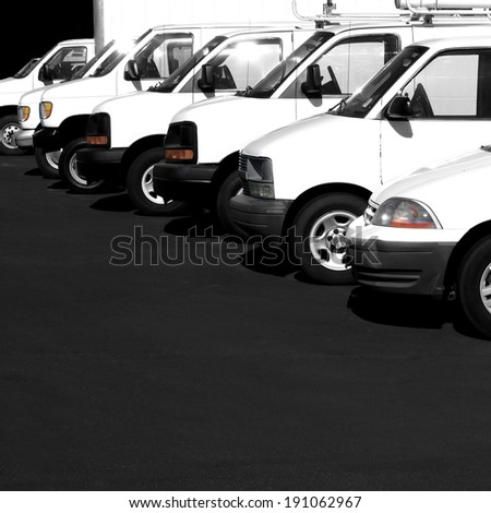 Several cars vans and trucks parked in parking lot for sale - stock photo