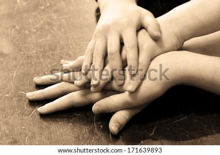 Several children hands on top of each other - stock photo