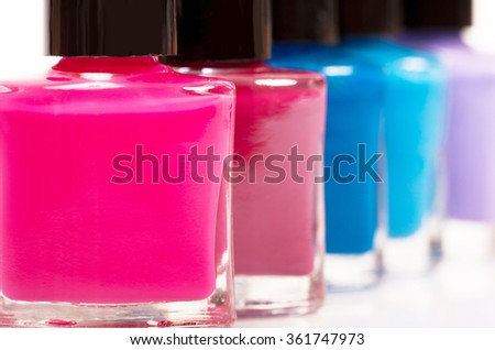 Several colored nail polish on a white background - stock photo