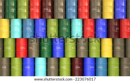 Several colored oil barrels stacked to form a wall. - stock photo