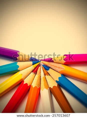 several colored pencils on white background, close up. instagram image retro style - stock photo