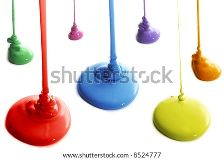 Several colors of paint pouring - stock photo