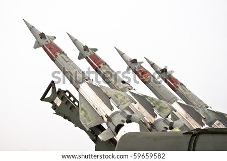 Several combat missiles aimed at the sky. Isolated on a white background. Missile weapons. - stock photo