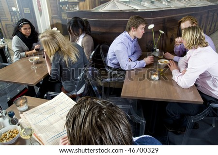several customers having a drink in a restaurant - stock photo